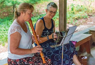 Campers playing music outdoors