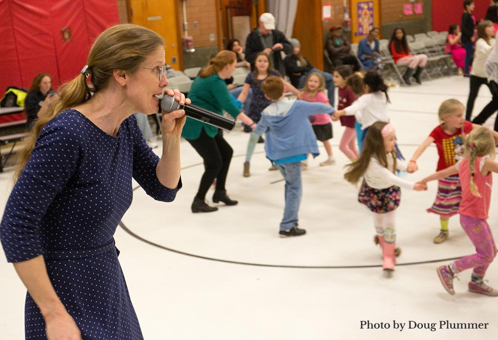 Caller leading a dance with small children