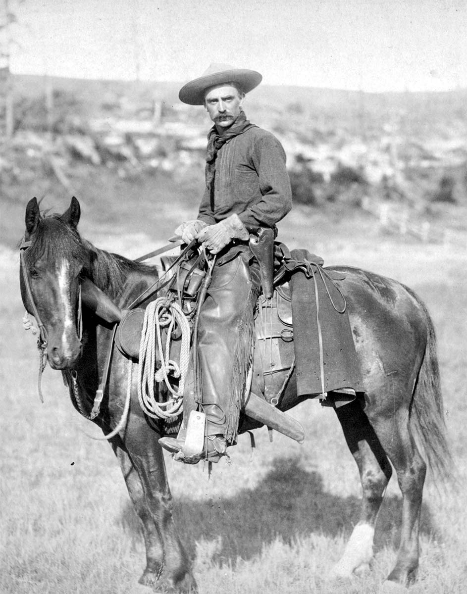 A cowboy sitting on his horse