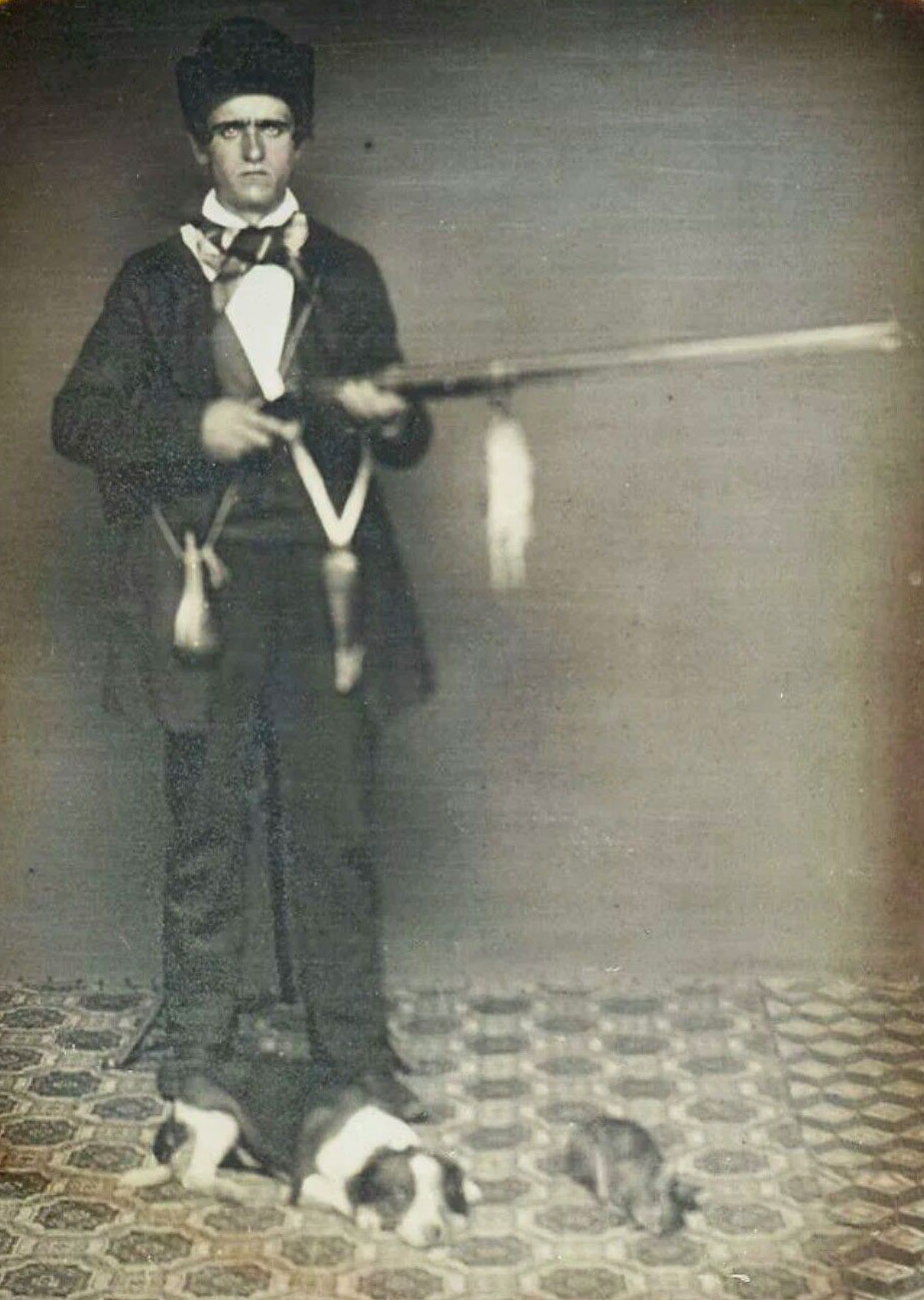 Daguerreotype photo of a young hunter with rifle and dog